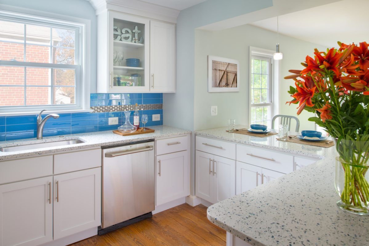 White Shaker Kitchen With Peninsula Crystal Cabinets