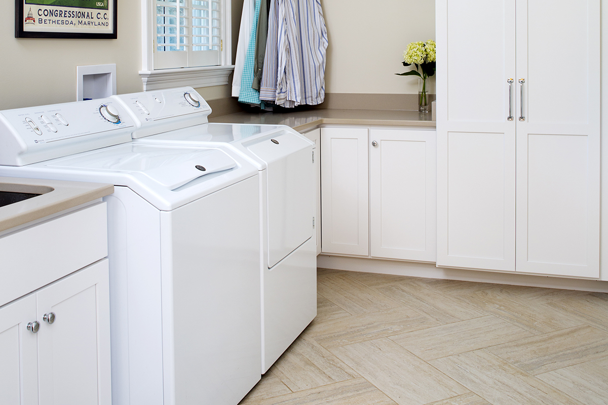 Simply White Laundry Room Crystal Cabinets