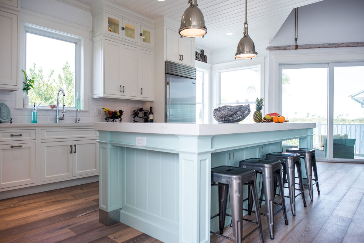 Coastal Style White Kitchen with Blue Island - Crystal Cabinets