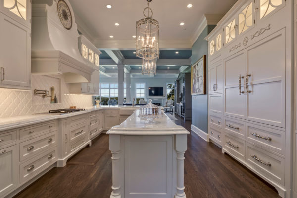Formal White Kitchen with Custom Clock Hood