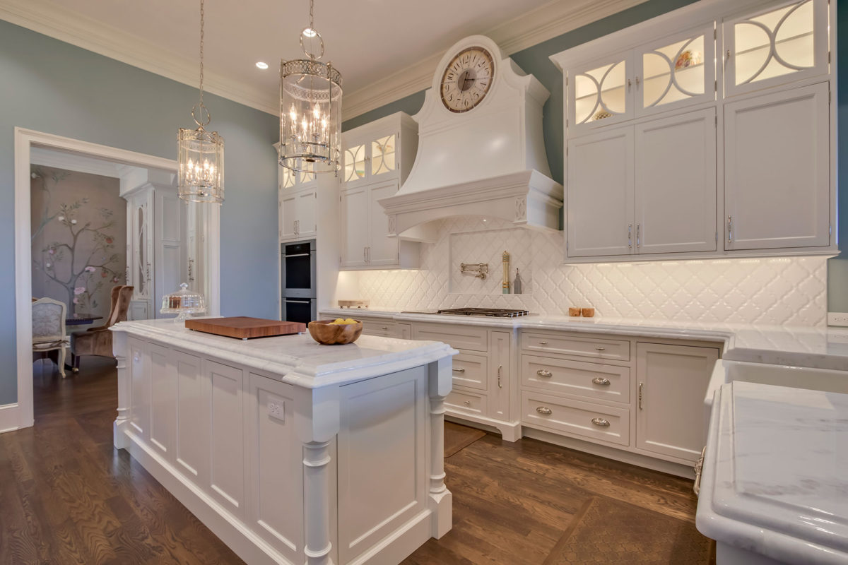 Formal White Kitchen With Custom Clock Hood Crystal Cabinets