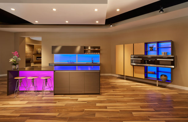 Grey Gloss Cabinetry with a Waterfall Island