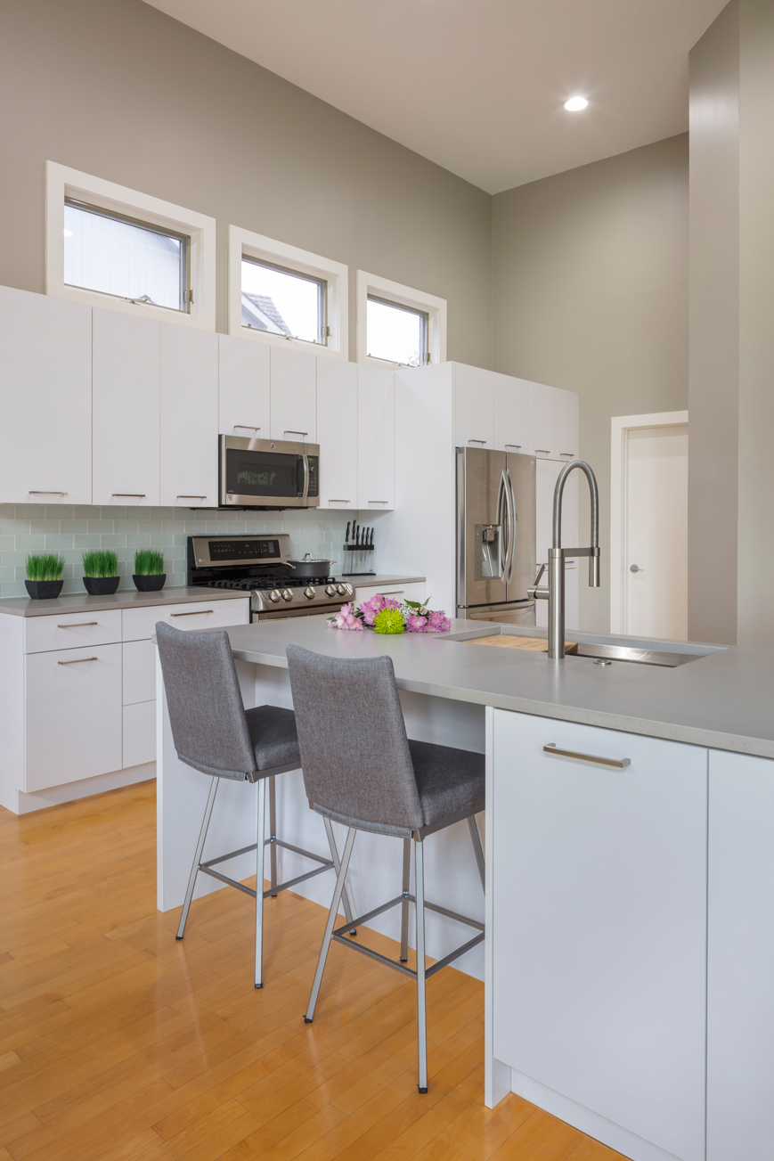 Contemporary White Laminate Kitchen - Crystal Cabinets