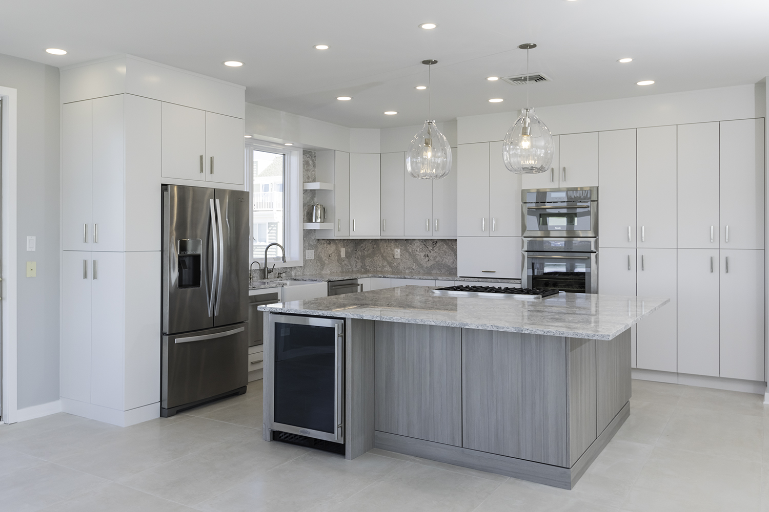 Contemporary White Laminate Kitchen With Gray Island